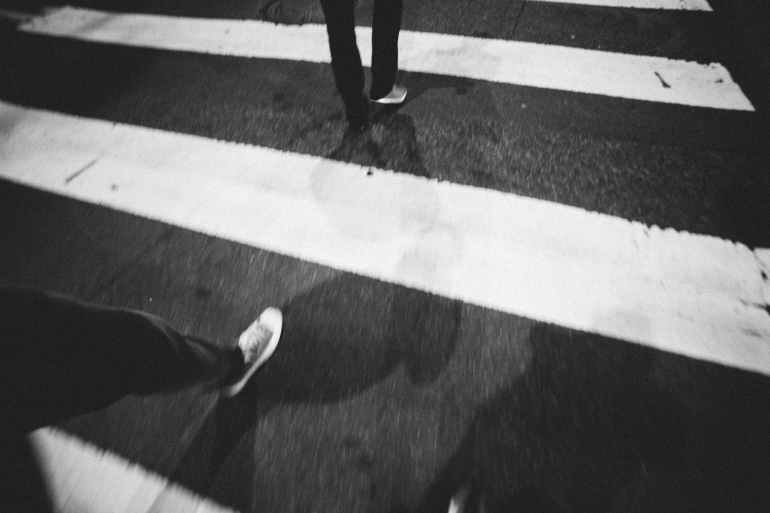 black and white street walking zebra crossing